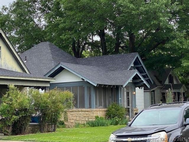 Garage featured at 409 E Seminole Ave, McAlester, OK 74501