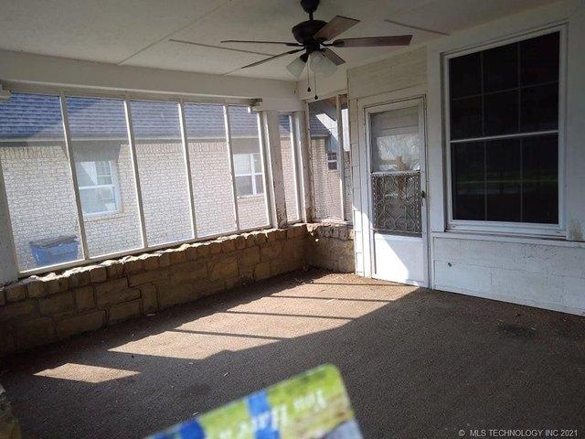 Porch featured at 409 E Seminole Ave, McAlester, OK 74501
