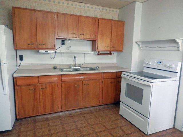 Kitchen featured at 129 N Locust St, Osborne, KS 67473