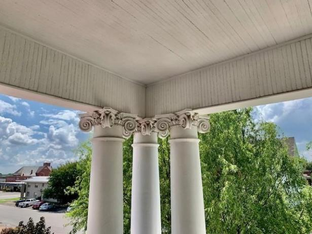 Porch featured at 412 W 9th St, Coffeyville, KS 67337