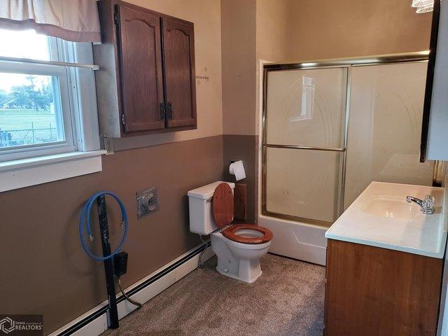 Bathroom featured at 204 Walnut St, Chelsea, IA 52215
