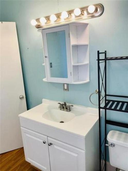 Bathroom featured at 321 N Julian St, Altus, OK 73521