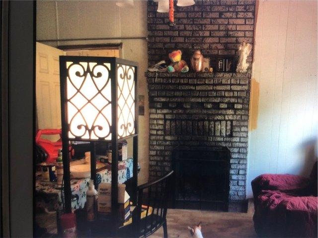Living room featured at 201 2nd St NE, Live Oak, FL 32064