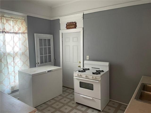 Laundry room featured at 2075 E William St, Decatur, IL 62521
