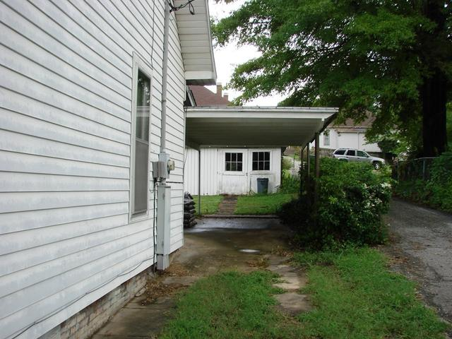 Porch yard featured at 107 N Porter St, Paris, TN 38242
