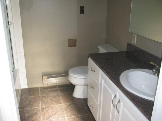 Bathroom featured at 301 S 4th St, Milbank, SD 57252