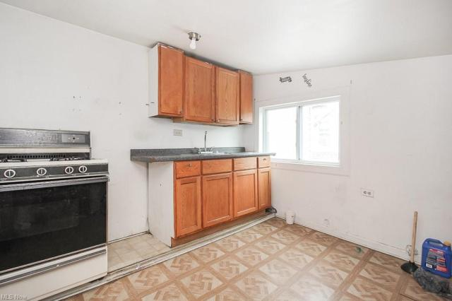 Kitchen featured at 321 W 8th St, Lorain, OH 44052