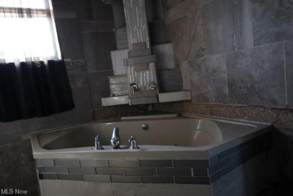 Bathroom featured at 1654 Cleveland Ave NW, Canton, OH 44703