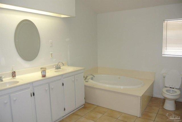 Bathroom featured at 5714 Sunbeam St, Milton, FL 32570