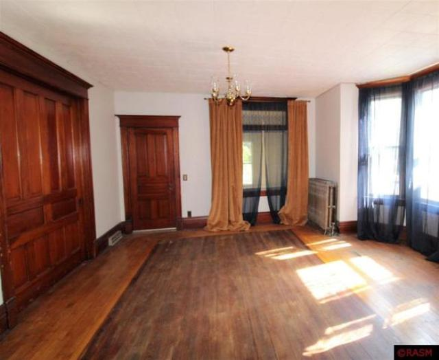 Living room featured at 418 S Broadway St, New Ulm, MN 56073