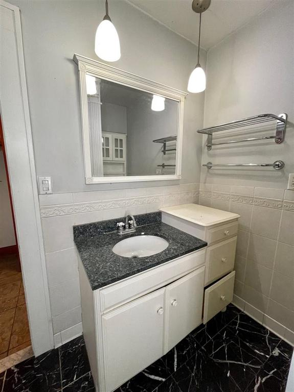 Bathroom featured at 1611 N Court St, Rockford, IL 61103