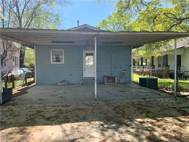 Porch yard featured at 605 Huron Ave, Bogalusa, LA 70427