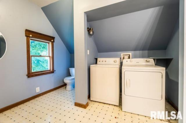 Laundry room featured at 1197 Clark St, Lowpoint, IL 61545