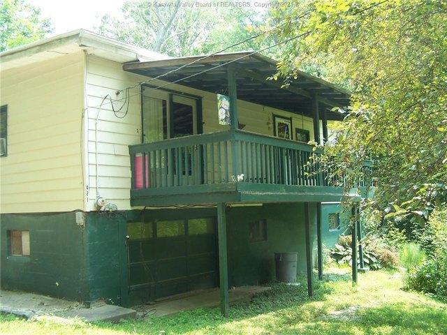 Porch yard featured at 228 Salt Lick Rd, Gallipolis Ferry, WV 25515