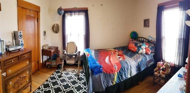 Bedroom featured at 321 E 1st St, Bison, KS 67520