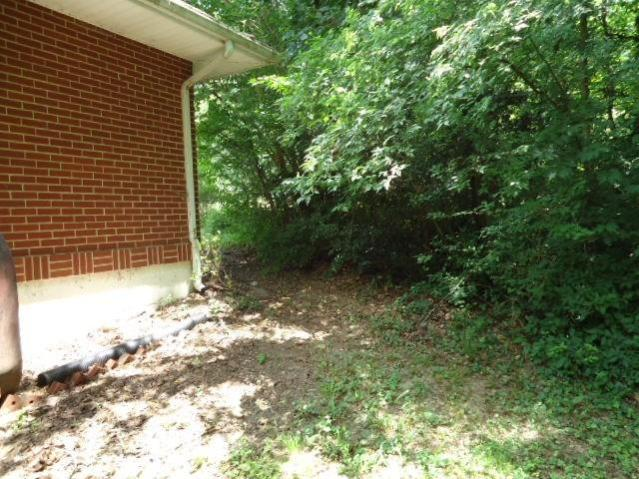 Porch yard featured at 818 Holland Rd, Danville, VA 24541