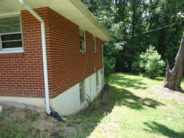 Yard featured at 818 Holland Rd, Danville, VA 24541
