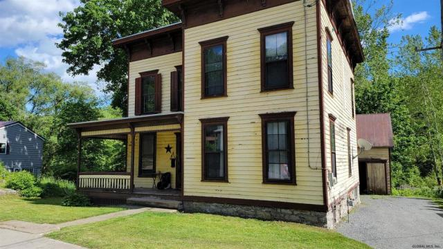 Porch yard featured at 29 Reid St, Fort Plain, NY 13339