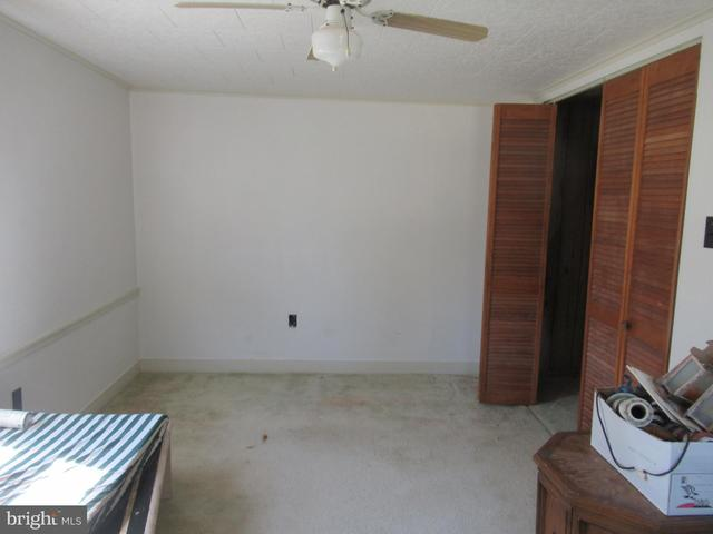 Bedroom featured at 26692 Old State Rd, Crisfield, MD 21817