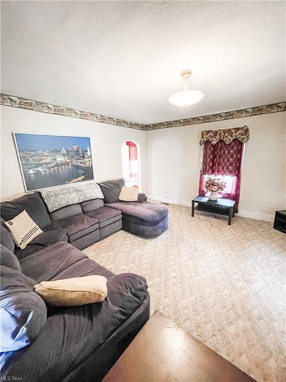 Living room featured at 874 W Main St, Adena, OH 43901