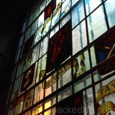 Best of Brussels - Fall In Love with Grand Place - Stained Glass representing the guilds of the city at Au Bon Vieux Temps just off Brussels Grand Place