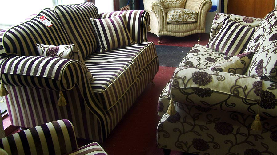 burgundy sofa and loveseat armrest remote control holder striped decor | apartments i like blog