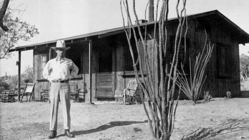 KT Palmer stands in front of his homestead on the western slopes of Pinnacle Peak.