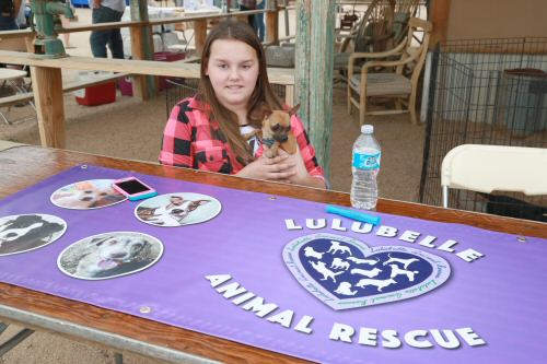 Volunteer, Julia Conklin, mans Lulubelle Animal Rescue exhibit with Peanut, her adopted dog. (Courtesy of Dennis Liddell.)
