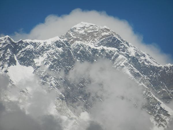 Everest Peeks Over Lhotse Ridge