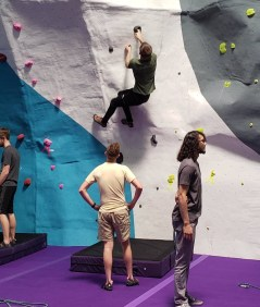 Man bouldering with a spotter