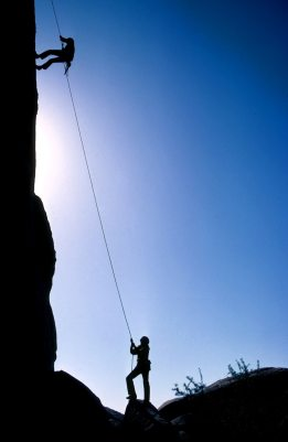 climbing instructor belaying a climber