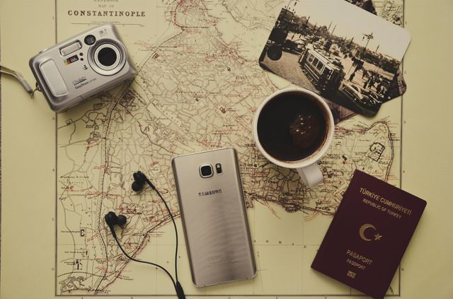 travel map, passport, smartphone, camera, and coffee