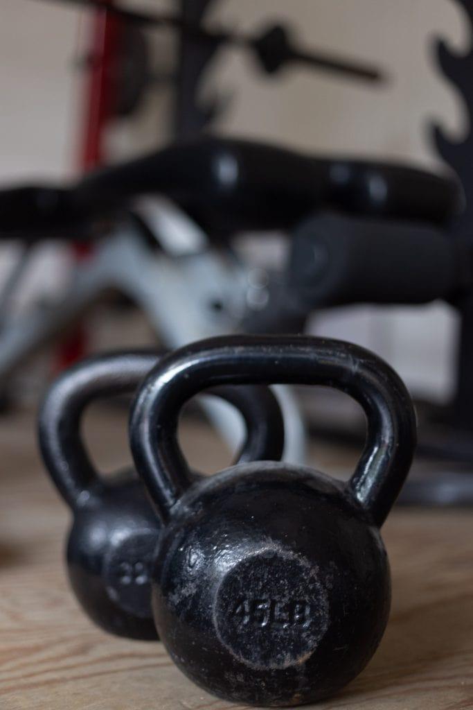 dumbbells on a garage gym floor.