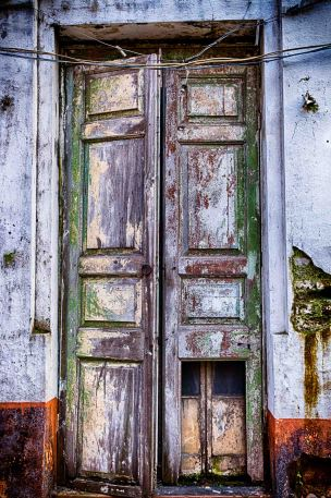 weathered door leading to different chambers