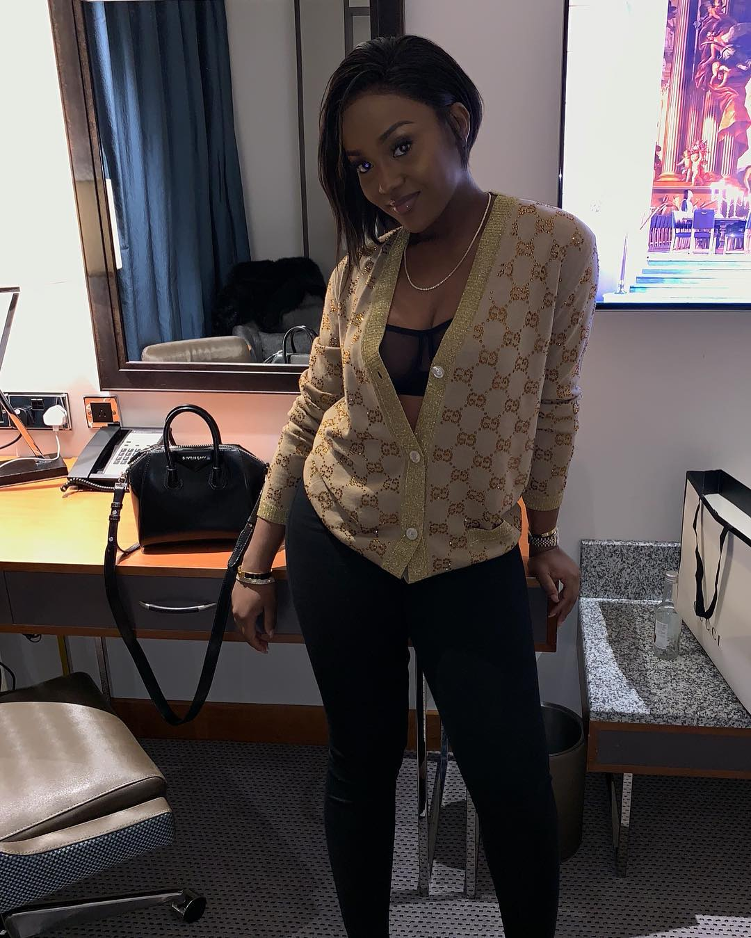 Chioma plays the perfect wife as she consoles a weeping