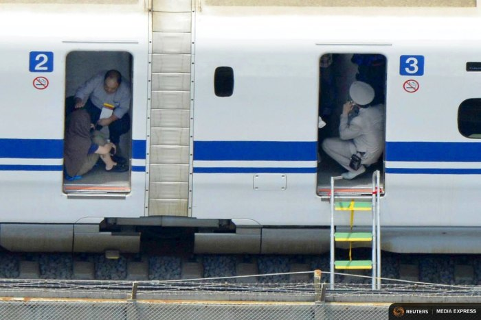 Passengers are seen inside a Shinkansen bullet train after it made an emergency stop in Odawara, south of Tokyo, in this aerial view photo taken by Kyodo June 30, 2015. REUTERS/Kyodo