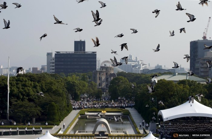 Doves fly over Peace Memorial Park with Atomic Bomb Dome (C) in the background, at a ceremony in Hiroshima, western Japan, August 6, 2015, on the 70th anniversary of the atomic bombing of the city. REUTERS/Toru Hanai