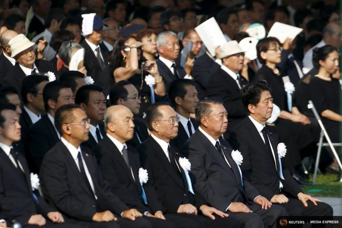Japan's Prime Minister Shinzo Abe and other dignitaries attend a ceremony at Peace Memorial Park in Hiroshima marking the 70th anniversary of the atomic bomb attack on the city, August 6, 2015. REUTERS/Thomas Peter