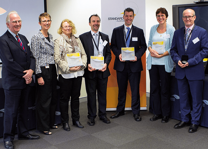 Standards Australia with 2015 Standards Awards winners: Chairman Richard Brooks, Chief Executive Officer Dr Bronwyn Evans, Robyn Williams, Enzo Alfonsetti, Dr Anthony Kachenko, Petra Hansen and Russell Shephard. Image courtesy of Standards Australia.