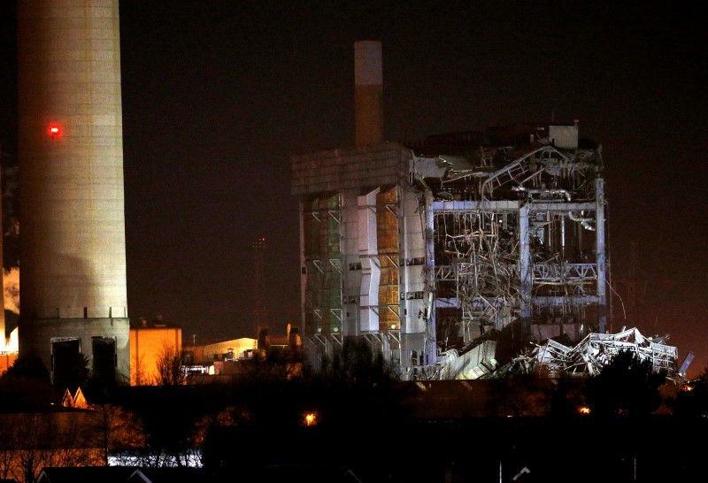 Part of a collapsed building is illuminated by the emergency services as they work at the decommissioned Didcot A power station in central England, February 23, 2016. REUTERS/Peter Nicholls