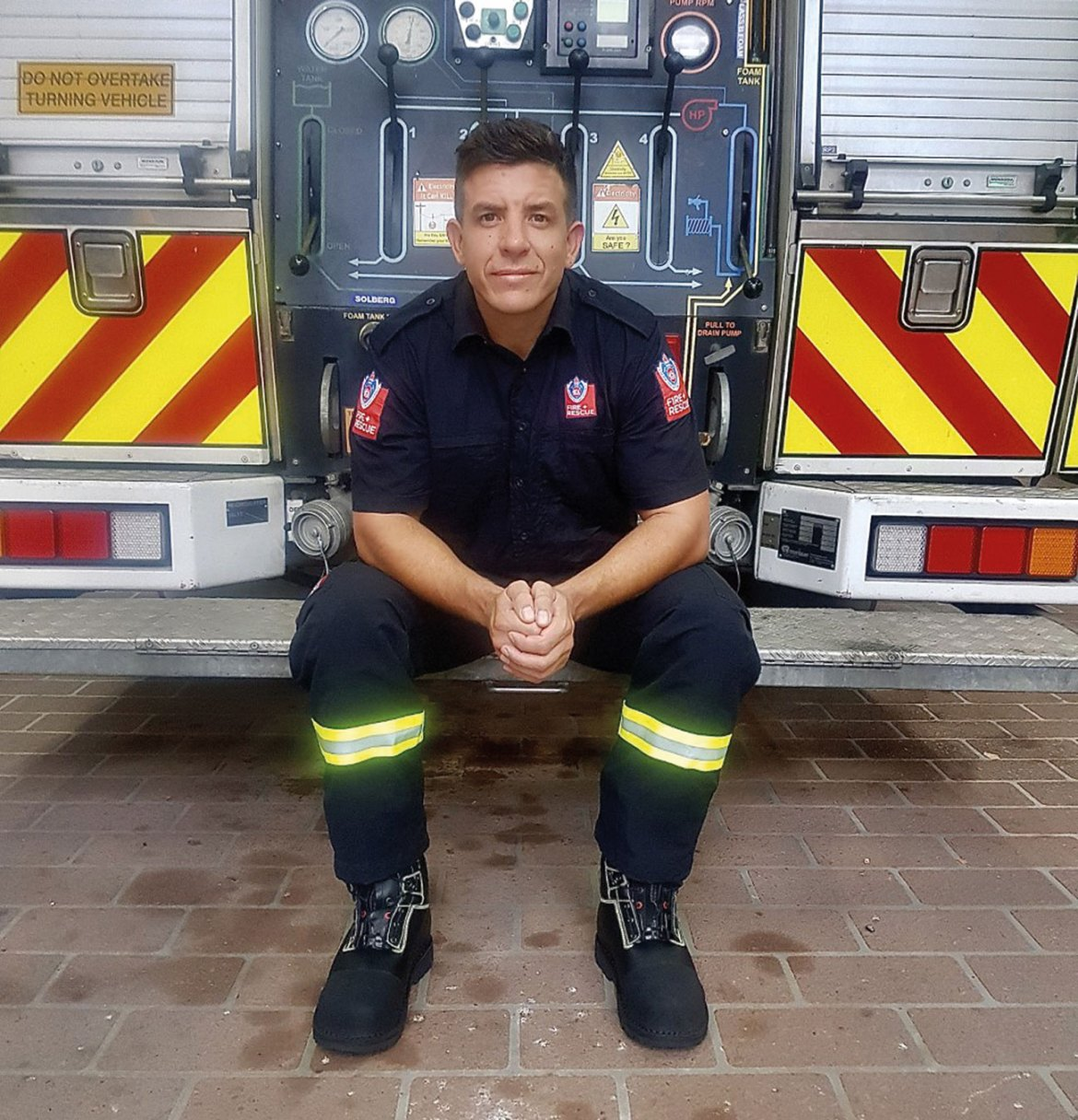 Firefighter Dixon, on duty, wearing his Jolly structural firefighitng boots.