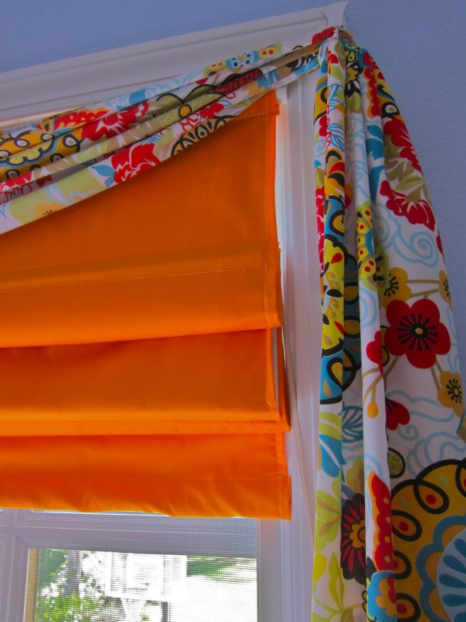 Custom roman shades with Sari print swag.