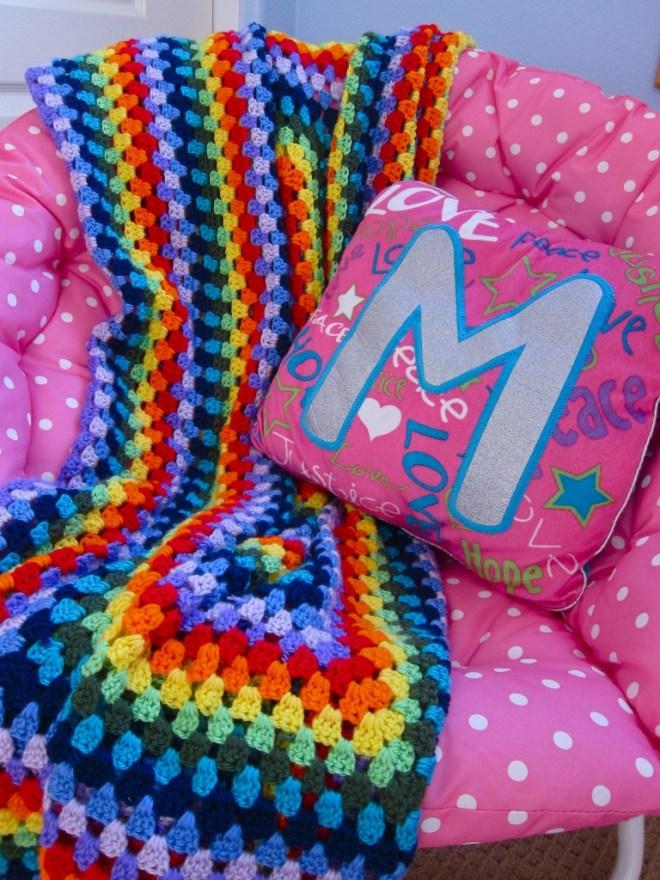 Handmade blanket in rainbow colors.