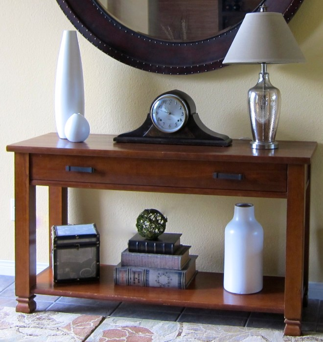 A well accessorized entry table.