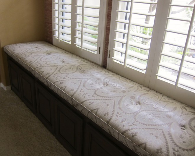 A custom silk blend cushion adds elegance to this window seat.