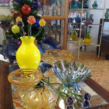 An assortment of artist creations on display and for sale in the storefront of Central Glass Works.