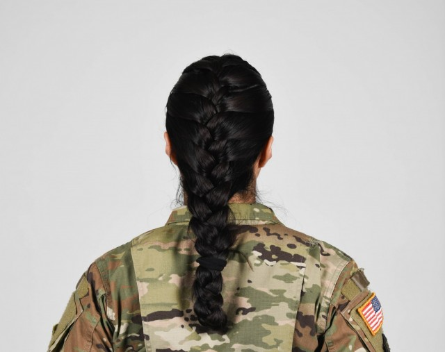 U.S. Army Soldier wearing new approved ponytail hair style.