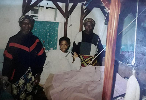 Nina, age 8, being treated in Banso hospital