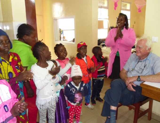 Children singing at Mbingo Baptist Hospital, Nov. 2019. Gracious and Prof Hesseling on the right