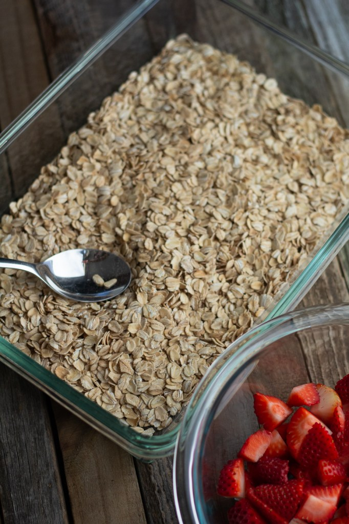 Adding dry oatmeal mixture to baking pan